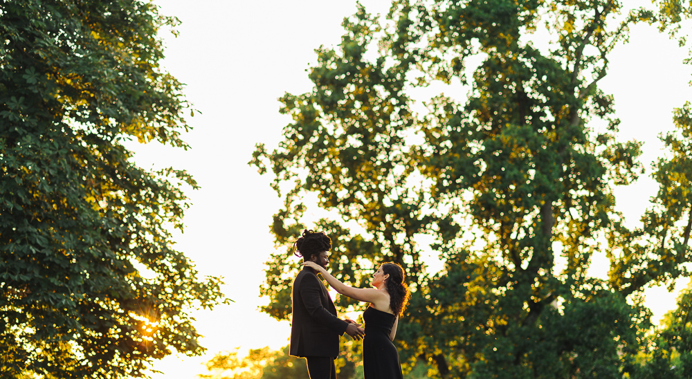 Couple Embracing while sun shines behind