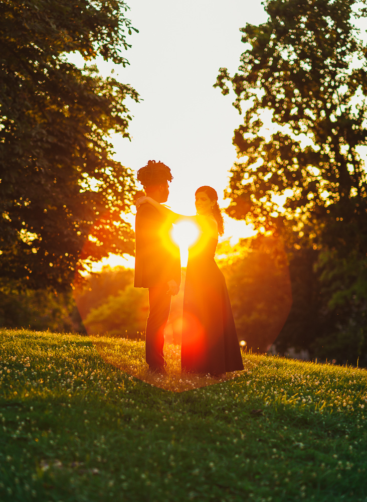 Couple Embracing while sunset shines through
