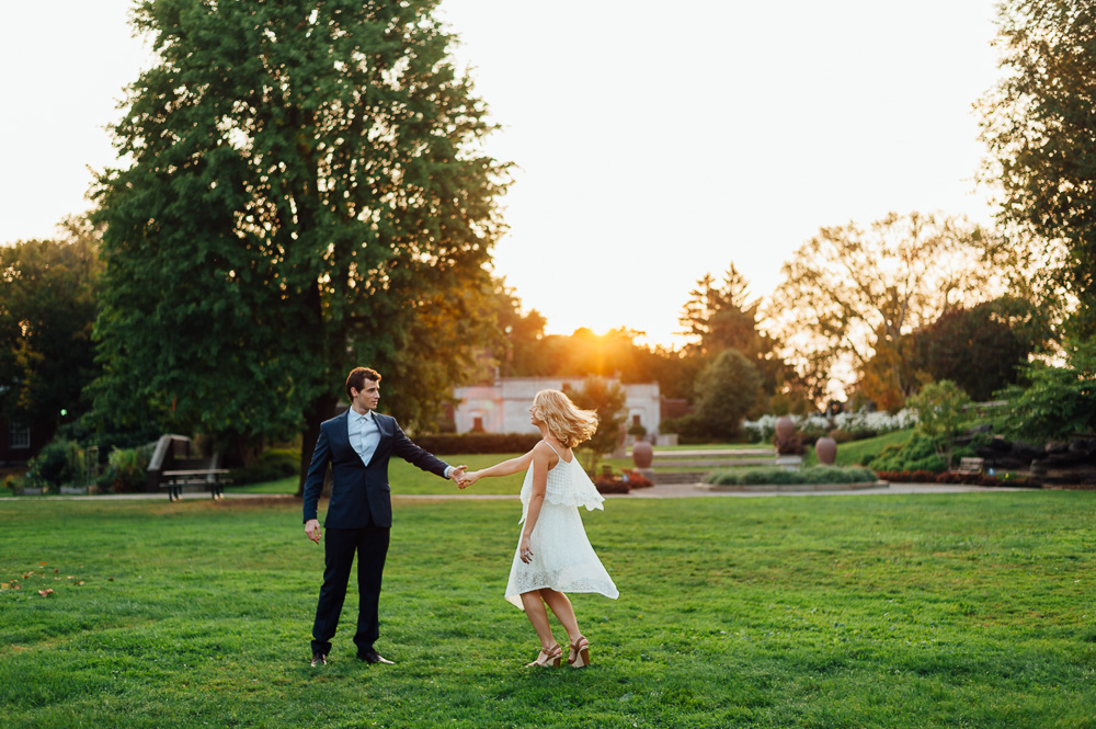 Married couple dancing at sunset
