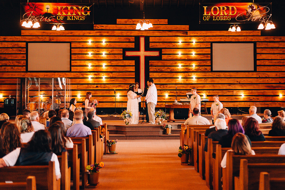 Bride and groom reading vows to each other