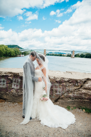 newly married couple wrapped in bride veil in washington landing wedding