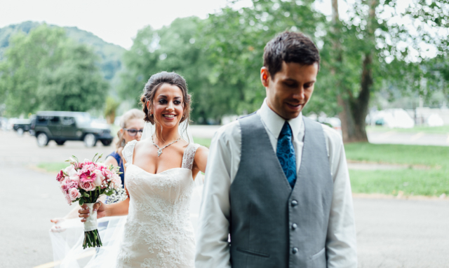 bride taps groom shoulder for their first look