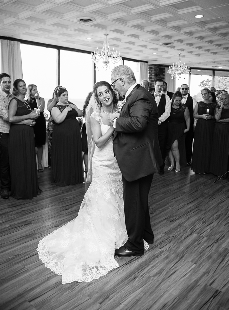 father of the bride dances with her daughter